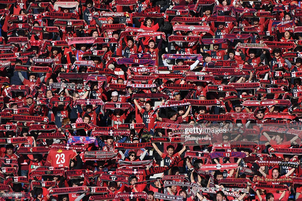 Supporters of Kashima Antlers hold mufflers prior to the 96th Emperor's Cup final match between Kashima Antlers and Kawasaki Frontale at Suita City Football Stadium on January 1, 2017 in Suita, Osaka, Japan.