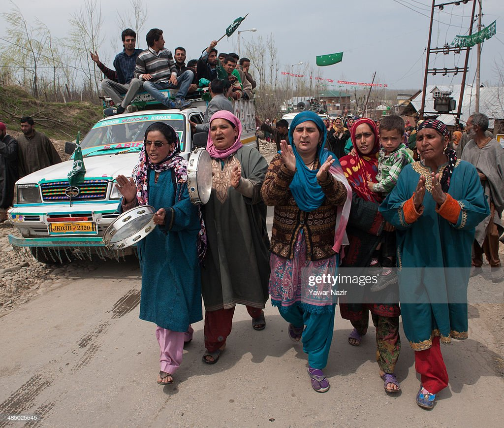 Supporters of Kashmir's main opposition political party, Peoples Democratic Party's (PDP) leader Mehbooba Mufti, and candidate for South Kashmir dance and sing during her road show on April 15, 2014, in Tsimer about 90 km south of Srinagar, the summer capital of Indian administered Kashmir, India.Kashmir's main opposition political party, Peoples Democratic Party's (PDP) leader Mehbooba Mufti, and candidate for South Kashmir started off with road shows across 21 villages as a part of her election campaign for the upcoming Lok Sabha polls on Tuesday. She started from Pahloo of the Noorabad constituency.
