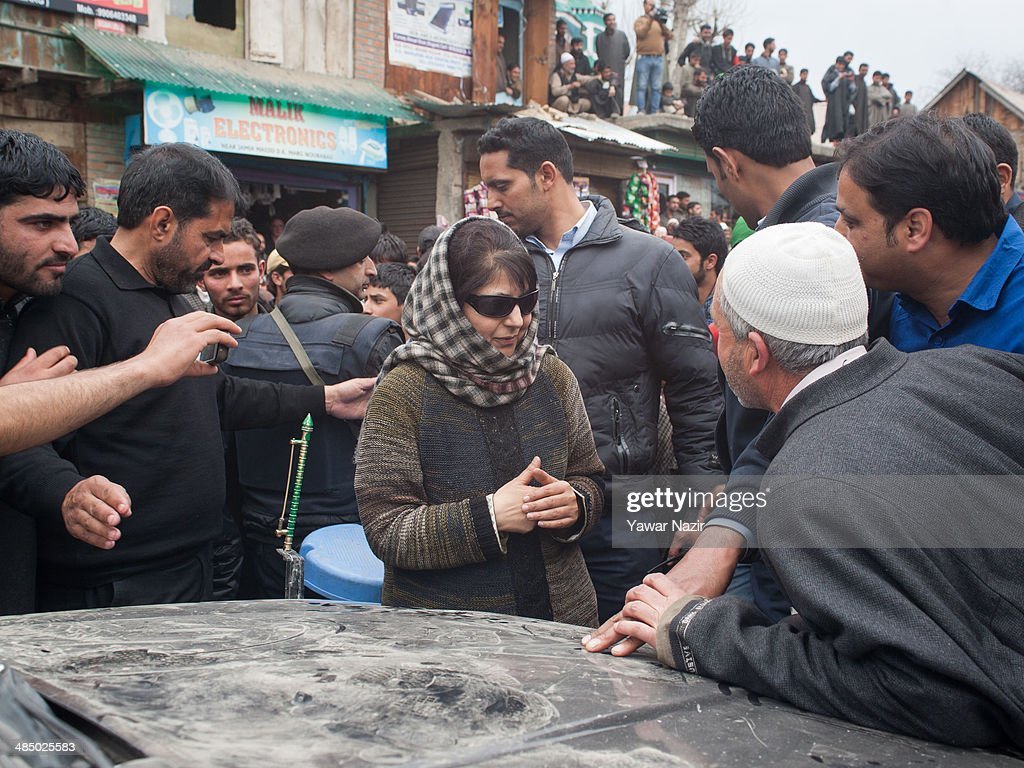 Supporters of Kashmir's main opposition political party, Peoples Democratic Party's (PDP) leader Mehbooba Mufti, and candidate for South Kashmir talks with her supporters during her road show on April 15, 2014, in Tsimer about 90 km south of Srinagar, the summer capital of Indian administered Kashmir, India.Kashmir's main opposition political party, Peoples Democratic Party's (PDP) leader Mehbooba Mufti, and candidate for South Kashmir started off with road shows across 21 villages as a part of her election campaign for the upcoming Lok Sabha polls on Tuesday. She started from Pahloo of the Noorabad constituency.