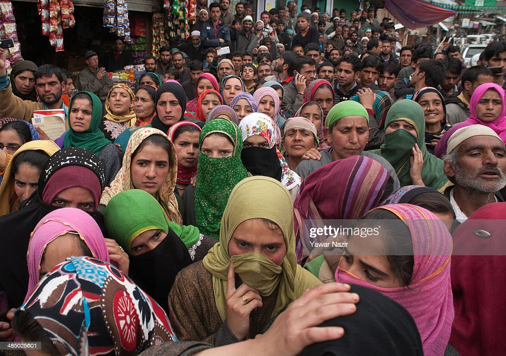 Supporters of Kashmir's main opposition political party, Peoples Democratic Party's (PDP) leader Mehbooba Mufti, and candidate for South Kashmir listen to her during her road show on April 15, 2014, in Tsimer about 90 km south of Srinagar, the summer capital of Indian administered Kashmir, India.Kashmir's main opposition political party, Peoples Democratic Party's (PDP) leader Mehbooba Mufti, and candidate for South Kashmir started off with road shows across 21 villages as a part of her election campaign for the upcoming Lok Sabha polls on Tuesday. She started from Pahloo of the Noorabad constituency.