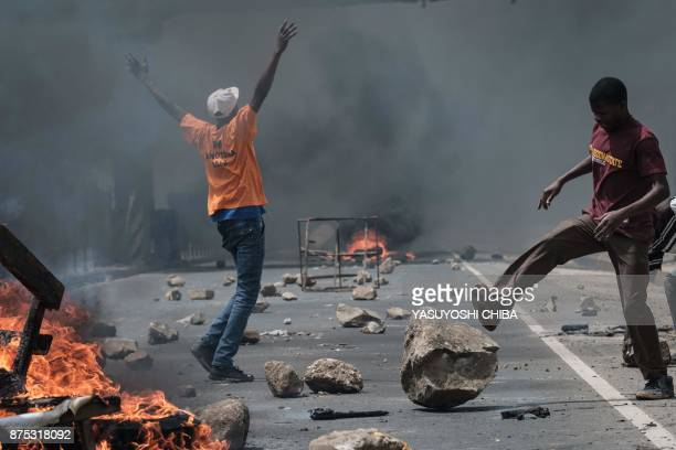 Supporters of Kenyan's opposition party National Super Alliance clash with police during a demonstration on November 17 2017 in Nairobi Opposition...