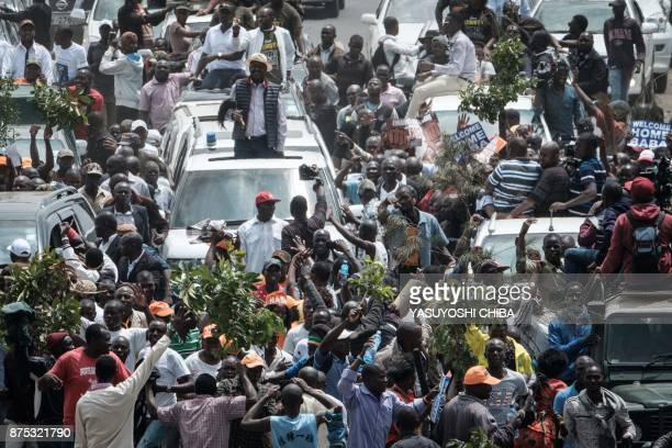 Supporters of Kenyan's opposition party National Super Alliance leader Raila Odinga march with his convoy upon his arrival to the Jomo Kenyatta...
