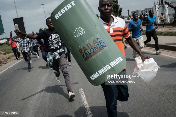 Supporters of Kenyan's opposition party National Super Alliance run to join a demonstration on November 17 2017 in Nairobi Opposition leader Raila...