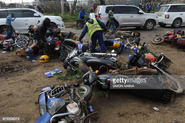 Supporters of Kenyan's opposition party National Super Alliance attempt to locate motorcycles following a stampede as Kenyan police dispersed a...