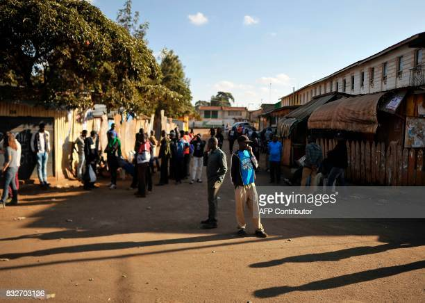 Supporters of Kenya's embattled opposition leader Raila Odinga gather in a commercial street after watching Odinga's press conference on August 16...