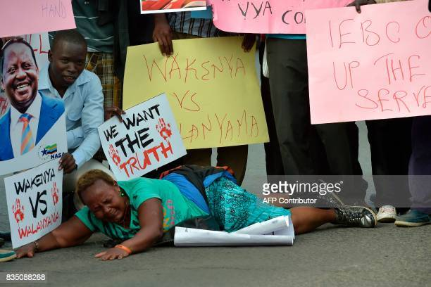 Supporters of Kenya's embattled opposition leader Raila Odinga protest outside the Supreme court in Nairobi on August 18 2017 to file a petition...