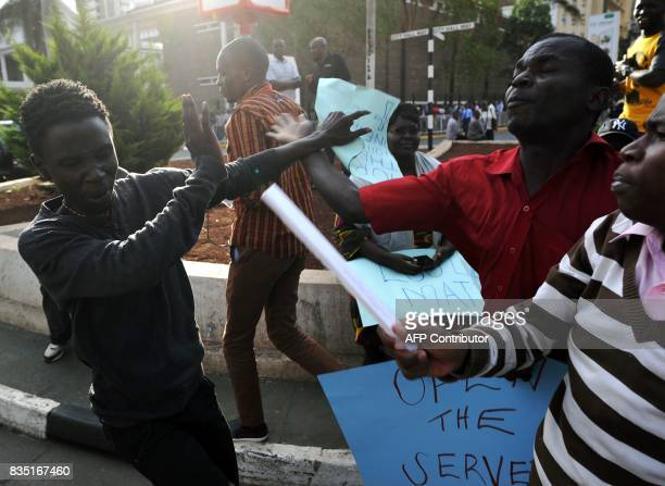 Supporters of Kenya's embattled opposition leader Raila Odinga scuffle with a man who scoffed at their claims of election rigging as they staged a...