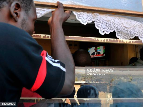 Supporters of Kenya's embattled opposition leader Raila Odinga watch Odinga on television as he gives a press conference on August 16 2017 in the...