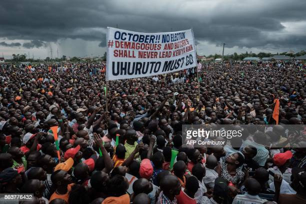 TOPSHOT Supporters of Kenya's opposition National Super Alliance coalition hold a banner during a political rally in Kisumu western Kenya on October...