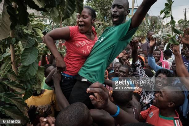 Supporters of Kenya's opposition National Super Alliance party celebrate on a street of Kibera slum in Nairobi on September 1 2017 Kenya's Supreme...