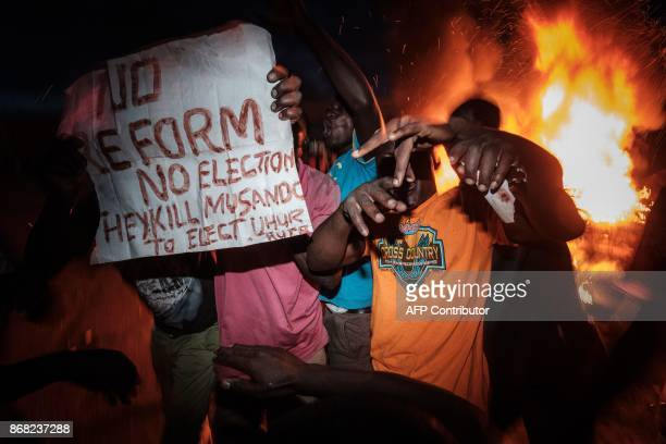 Supporters of Kenya's opposition National Super Alliance react following the announcement of results of a presidential election rerun in Kisumu on...