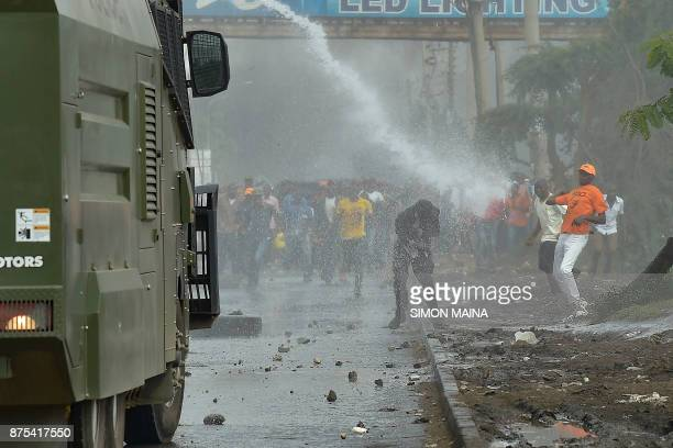 Supporters of Kenya's opposition party National Super Alliance clash with police during a demonstration on November 17 2017 in Nairobi Three men were...