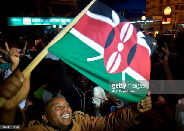 Supporters of Kenya's President Uhuru Kenyatta celebrate after Kenyatta was declared the winner following presidential reelection results by Kenya's...