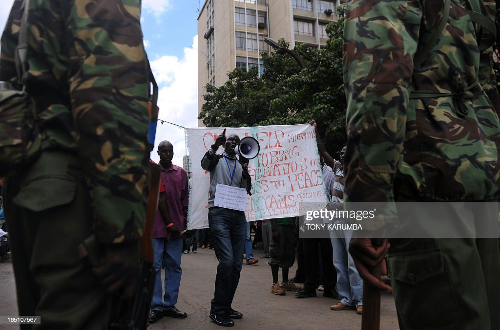 Supporters of Kenya's Prime Minister and CORD alliance presidential candidate demonstrate outside the Supreme Court in Nairobi on March 30, 2013 before the ruling of a petition hearing at the Kenya Supreme court by outgoing Prime Minister Raila Odinga challenging election contender Uhuru Kenyatta, was due to be delivered by a six-judge bench. Kenya's Supreme court on March 30 upheld the victory of uhuru Kenyatta in the March 4, election Chief Justice Willy Mutunga said. The court unanimously ruled that the election had been fair and credible and that Kenyatta and his running mate had been validly elected. AFP PHOTO/Tony KARUMBA