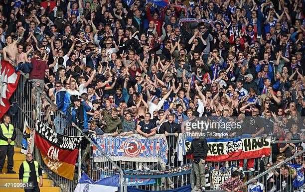 Supporters of Kiel cheer their team during the Third League match between Arminia Bielefeld and Holstein Kiel at Schueco Arena on May 2 2015 in...