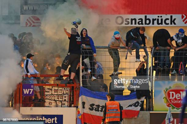 Supporters of Kiel fire smoke bombs during the Third League match between VfL Osnabrueck and Holstein Kiel at the Osnatel Arena on April 30 2010 in...