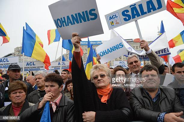 Supporters of Klaus Iohannis candidate for presidency of Romania take part in launching of his candidacy at Victoria square in Bucharest September 27...