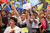 Supporters of Ko Wenje cheer during opening the ballots box at Ko's headquarters on November 29 2014 in Taipei Taiwan Millions of voters go to the...