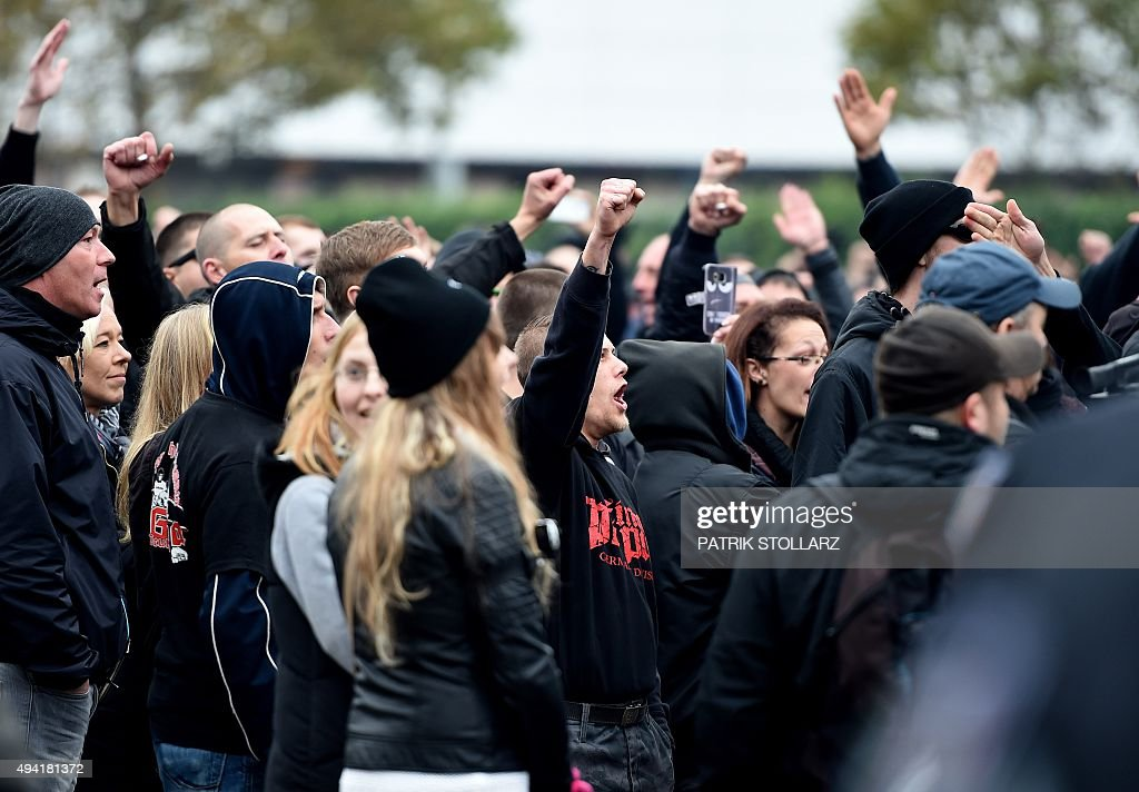 Supporters of KOEGIDA the Colognechapter of the xenophobic PEGIDA movement and of HoGeSa farright extremists massed under the banner 'Hooligans...