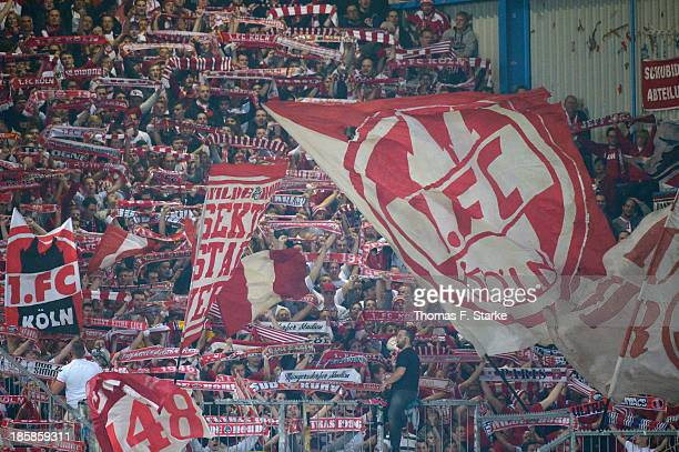 Supporters of Koeln cheer their team during the Second Bundesliga match between Arminia Bielefeld and 1 FC Koeln at the Schueco Arena on October 25...