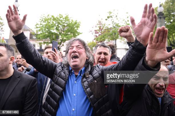 Supporters of Kosovo's former Prime Minister Ramush Haradinaj react as they hear the result of his extradition hearting outside the Court in Colmar...