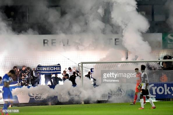 Supporters of KRC Genk are covered in smoke during the Croky Cup 1/16 final match between SC Eendracht Aalst and KRC Genk in the Pierre Cornelis...