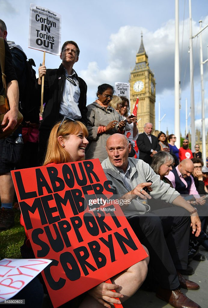 Supporters of Labour leader Jeremy Corbyn chat during Momentum's 'Keep Corbyn' rally outside the Houses of Parliament on June 27, 2016 in London, England. The Labour Leader has seen mass resignations from the Shadow Cabinet in the wake of the UK Vote for Brexit. His support group, Momentum, have recorded more than 1000 new members in the same period.