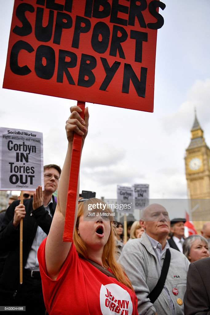 Supporters of Labour leader Jeremy Corbyn hold up signs and shout during Momentum's 'Keep Corbyn' rally outside the Houses of Parliament on June 27, 2016 in London, England. The Labour Leader has seen mass resignations from the Shadow Cabinet in the wake of the UK Vote for Brexit. His support group, Momentum, have recorded more than 1000 new members in the same period.
