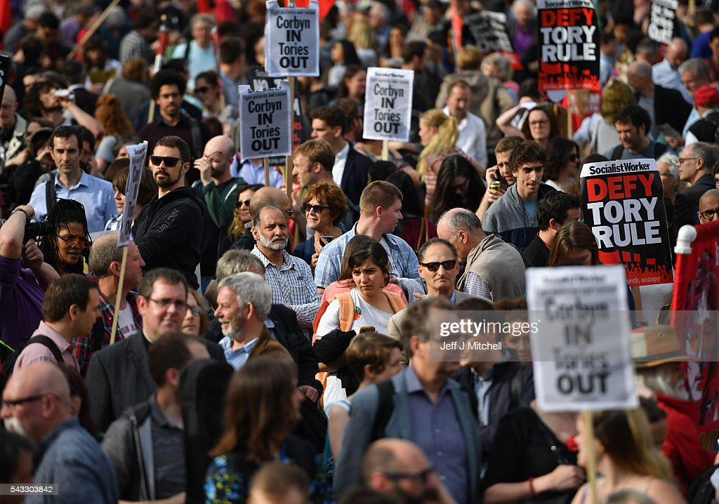 Supporters of Labour leader Jeremy Corbyn hold up signs during Momentum's 'Keep Corbyn' rally outside the Houses of Parliament on June 27, 2016 in London, England. The Labour Leader has seen mass resignations from the Shadow Cabinet in the wake of the UK Vote for Brexit. His support group, Momentum, have recorded more than 1000 new members in the same period.