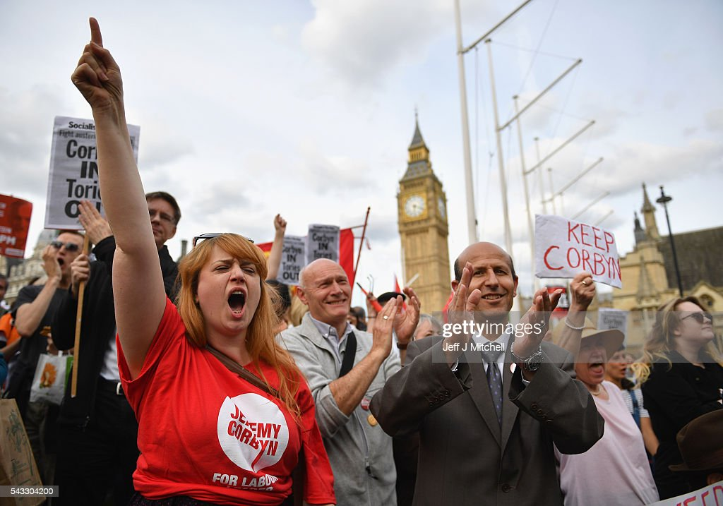 Supporters of Labour leader Jeremy Corbyn shout and clap during Momentum's 'Keep Corbyn' rally outside the Houses of Parliament on June 27, 2016 in London, England. The Labour Leader has seen mass resignations from the Shadow Cabinet in the wake of the UK Vote for Brexit. His support group, Momentum, have recorded more than 1000 new members in the same period.