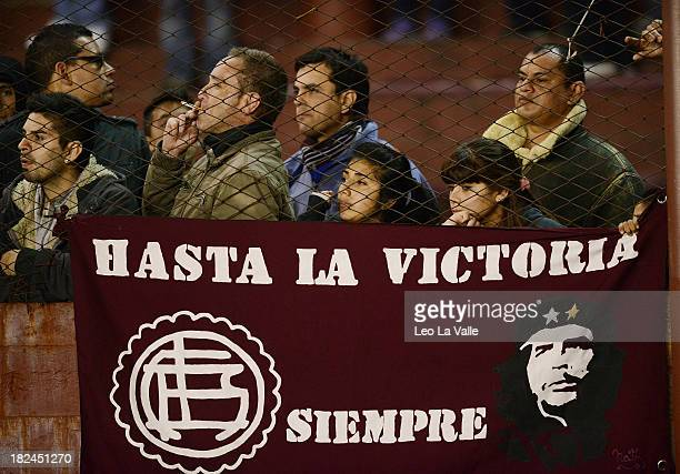 Supporters of Lanus cheer for their team during a match between Lanus and River Plate as part of the Torneo Inicial 2013 at Nestor Diaz Perez stadium...