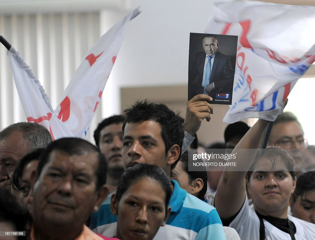 Supporters of late Paraguayan general Lino Oviedo cheer during the registration of the presidential candidate for the (UNACE) party, Lino Cesar Oviedo on February 15, 2013 in Asuncion. Paraguay will hold its presidential elections next April 21.