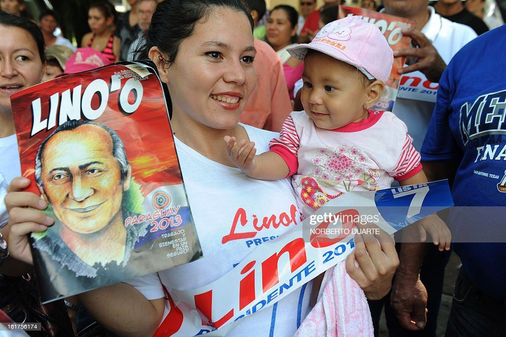 Supporters of late Paraguayan general Lino Oviedo cheer during the registration of the presidential candidate for the (UNACE) party, Lino Cesar Oviedo on February 15, 2013 in Asuncion. Paraguay will hold its presidential elections next April 21. AFP PHOTO/NORBERTO DUARTE