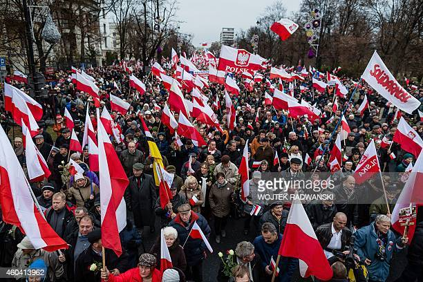 Supporters of Law and Justice right wing opposition party take part in massive demonstration in Warsaw on December 13 2014 Tens of thousands of...