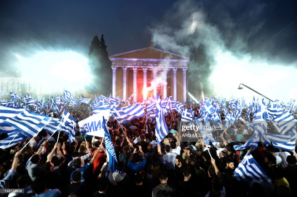 Supporters of Leader of the Greek conservative party New Democracy Antonis Samaras wave flags during a preelection speech in Athens on May 3 2012...