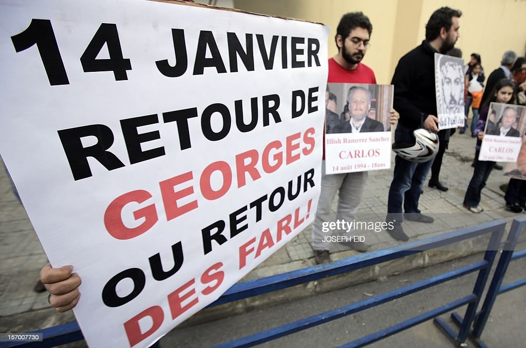 Supporters of Lebanese militant Georges Ibrahim Abdallah demonstrate outside the French embassy in Beirut demanding his release on November 27, 2012. Abdallah, who was imprisoned for 28 years in France for complicity in the murder of two diplomats in Paris in 1982, was granted parole last week but remains in prison as French prosecutors appealed this decision.
