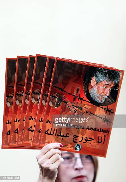 Supporters of Lebanese militant Georges Ibrahim Abdallah demonstrate outside the French embassy in Beirut demanding his release on November 27 2012...