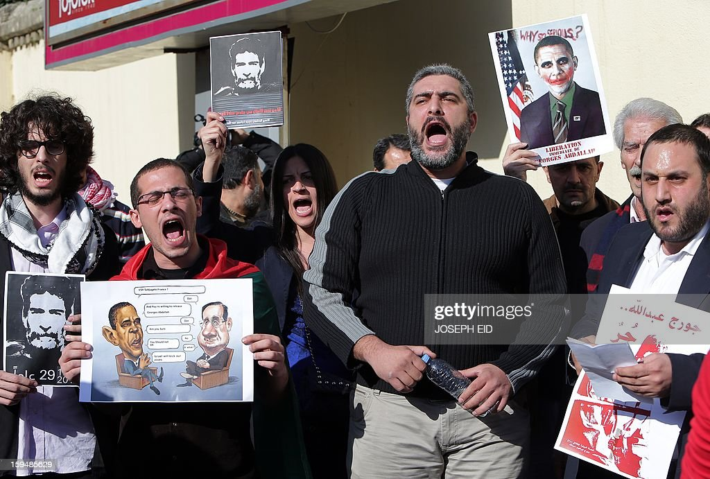 Supporters of Lebanese militant Georges Ibrahim Abdallah demonstrate outside the French embassy in Beirut to protest against the decision of French interior minister not to sign the documents for his extradition on January 14, 2013. Abdallah, is imprisoned for 28 years in France for complicity in the murder of two diplomats in Paris in 1982.