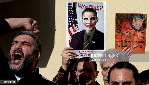 Supporters of Lebanese militant Georges Ibrahim Abdallah hold placards and shout slogans during a protest outside the French embassy in Beirut...
