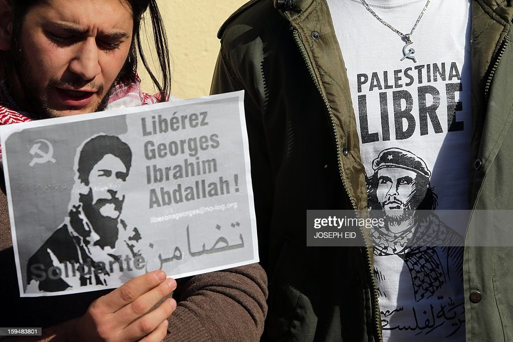 Supporters of Lebanese militant Georges Ibrahim Abdallah shows placards during a protest outside the French embassy in Beirut against the decision of French interior minister not to sign the documents for his extradition on January 14, 2013. Abdallah, is imprisoned for 28 years in France for complicity in the murder of two diplomats in Paris in 1982.