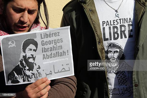 Supporters of Lebanese militant Georges Ibrahim Abdallah shows placards during a protest outside the French embassy in Beirut against the decision of...