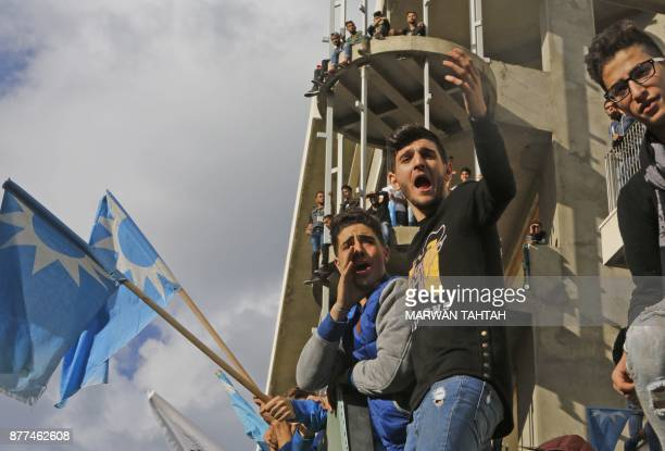 Supporters of Lebanese prime minister Saad Hariri wave the Future Movement flag as they gather at his home in Beirut on November 22 2017 Hariri back...