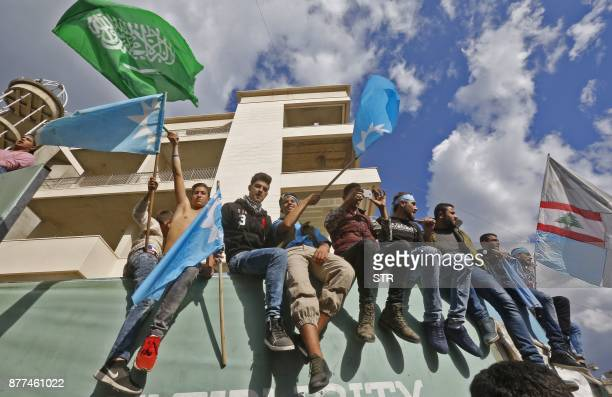 Supporters of Lebanese prime minister Saad Hariri wave the Lebanese flag alongside the Saudi and Future Movement flags as they gather at his home in...