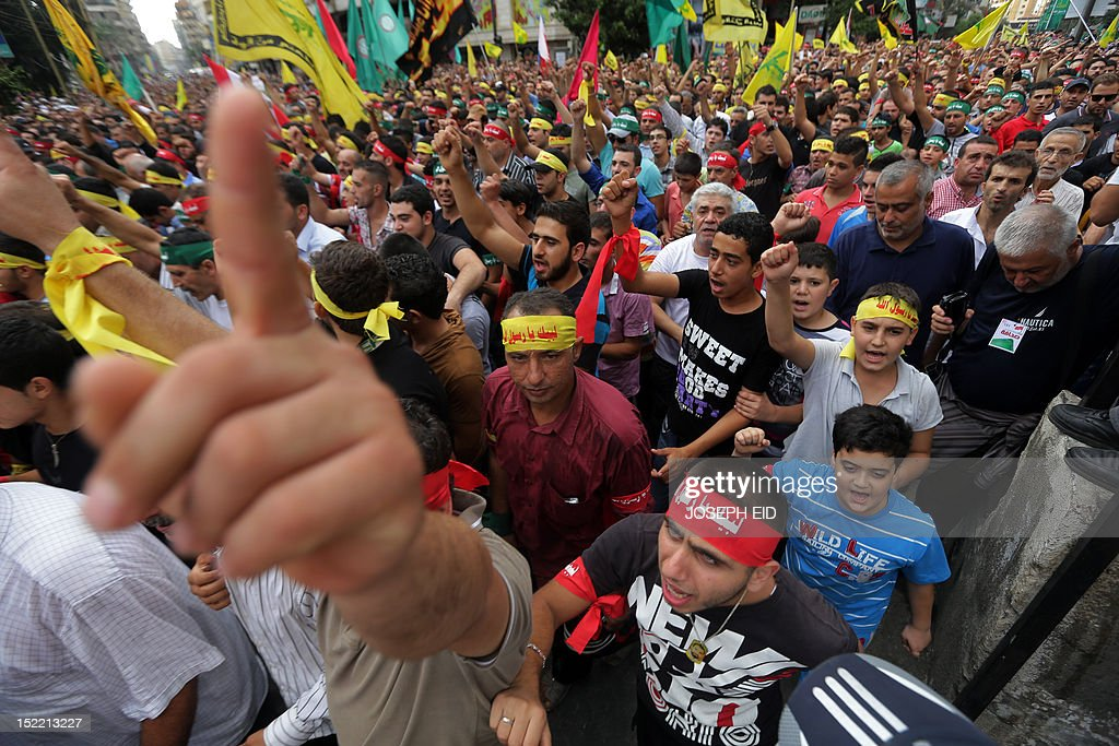 Supporters of Lebanon's Hezbollah group march during a rally in southern Beirut to denounce a film mocking Islam on September 17, 2012. Hezbollah chief Hassan Nasrallah, who made a rare public appearance at the rally, has called for a week of protests across the country over the low-budget, US-made film, describing it as the 'worst attack ever on Islam.' AFP PHOTO / JOSEPH EID