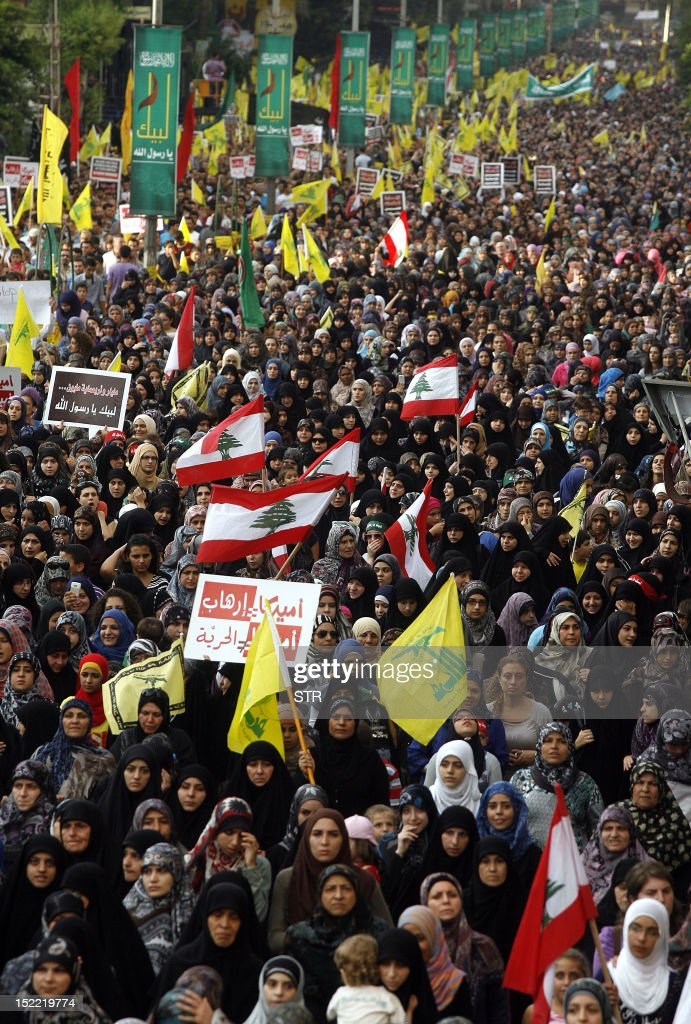 Supporters of Lebanon's Hezbollah group march during a rally in southern Beirut to denounce a film mocking Islam on September 17, 2012. Hezbollah chief Hassan Nasrallah, who made a rare public appearance at the rally, has called for a week of protests across the country over the low-budget, US-made film, describing it as the 'worst attack ever on Islam.' AFP PHOTO / STR