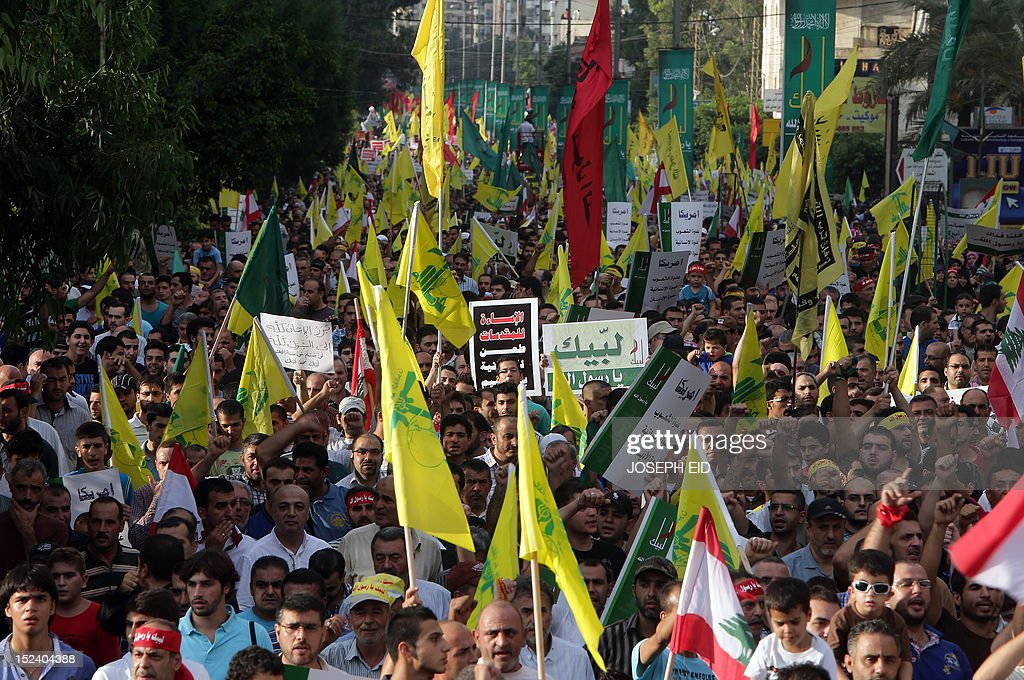 Supporters of Lebanon's Hezbollah group march during a rally in southern Beirut to denounce a film mocking Islam on September 17, 2012. Hezbollah chief Hassan Nasrallah, who made a rare public appearance at the rally, has called for a week of protests across the country over the low-budget, US-made film, describing it as the 'worst attack ever on Islam.'