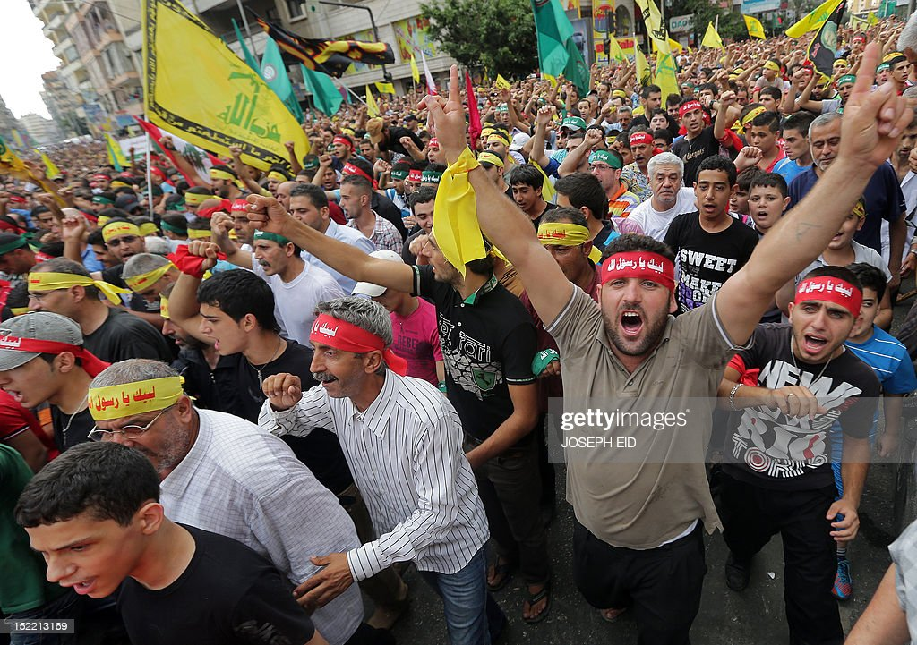 Supporters of Lebanon's Hezbollah group shout slogans during a rally in southern Beirut to denounce a film mocking Islam on September 17, 2012. Hezbollah chief Hassan Nasrallah, who made a rare public appearance at the rally, has called for a week of protests across the country over the low-budget, US-made film, describing it as the 'worst attack ever on Islam.' AFP PHOTO / JOSEPH EID