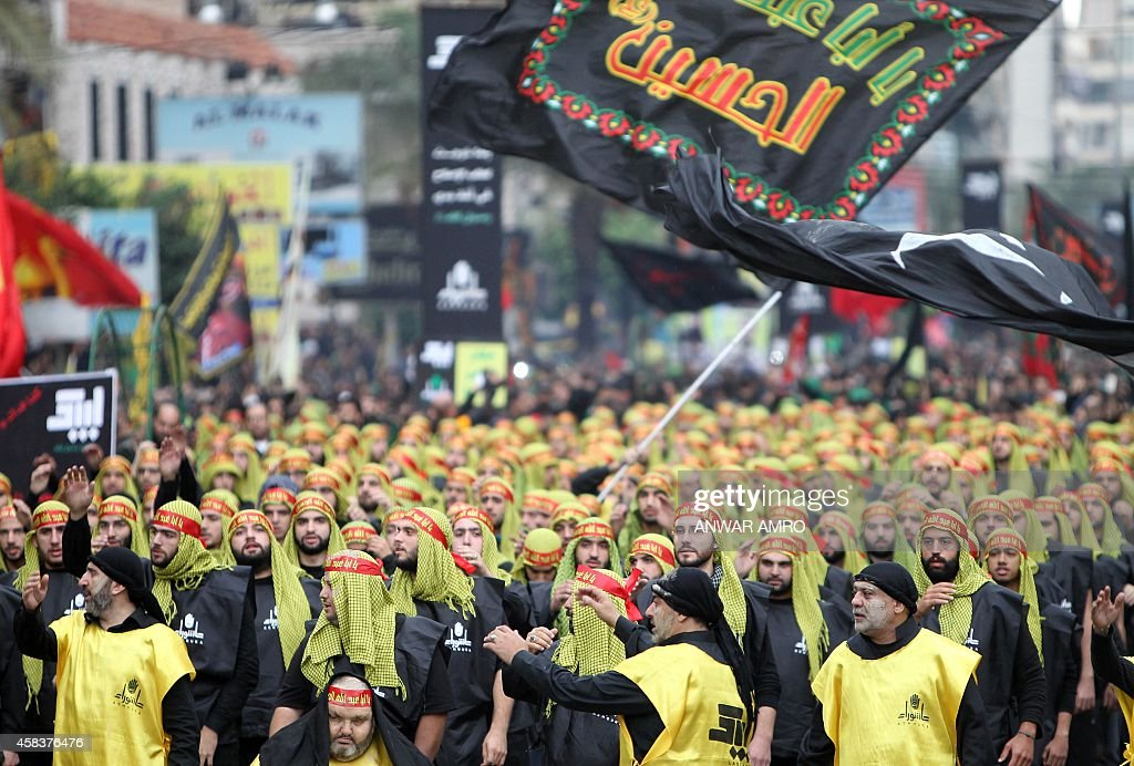 Supporters of Lebanon's militant Shiite Muslim movement Hezbollah take part in a parade during the Ashura commemorations that mark the killing of...