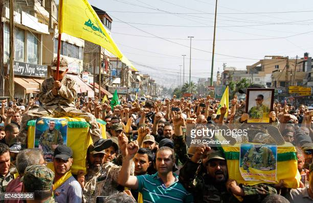 Supporters of Lebanon's Shiite Hezbollah movement carry the coffins of Hezbollah fighters killed in the Hezbollahled assault on AlQaeda's former...