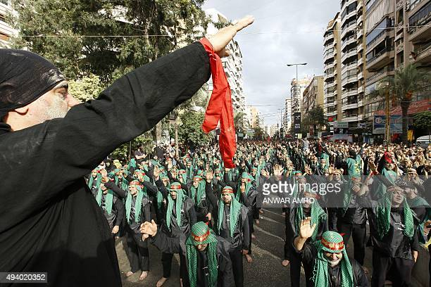 Supporters of Lebanon's Shiite Hezbollah movement shout slogans during a rally marking Ashura on the tenth day of the mourning period of Muharram in...
